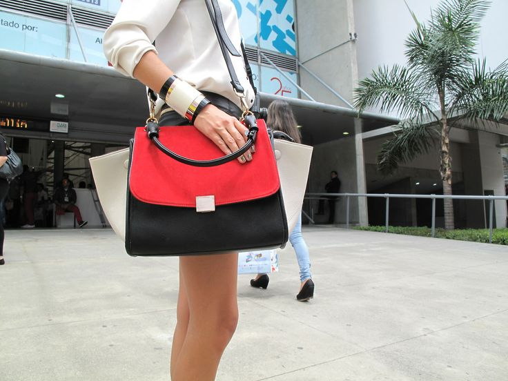 Street Chic-The Trinity Black, white and red are the perfect trinity. They work in almost every item and in this purse they work like a charm. Think also in a black and white dress with a red coat… Love it? We certainly do.