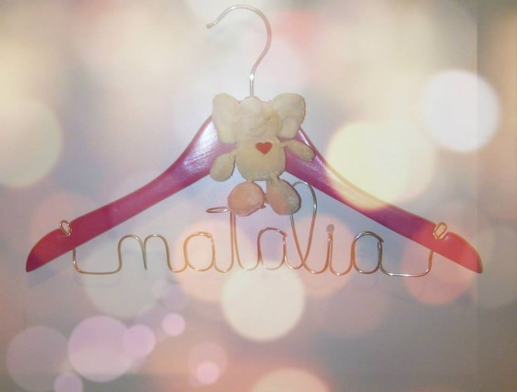 Personalized pink baby hanger with plush elephant