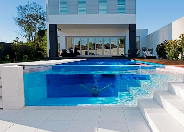 Love this glass wall pool idea!