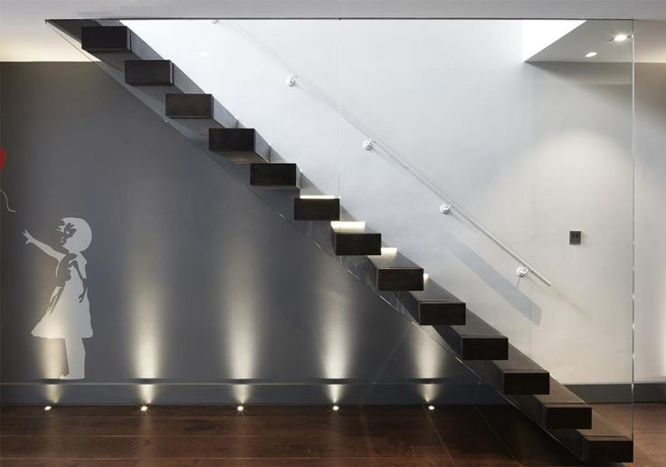 Detail of the contemporary staircase in our Richmond house. When we excavated the basement we gave it a modern feel to contrast with the period home above, including Banksy style print.