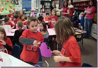"""Playing a racing game called """"Broken Heart"""". They had to pass a tissue paper heart back and forth using a clothes pin without breaking the heart. Another quiet minute as they concentrated so hard!"""