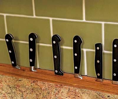 This built-in knife block was created from a slotted 12-inch-long insert of canary wood and makes use of the 3 inches of dead space behind the base cabinets. | Photo: Alise O'Brien | thisoldhouse.com