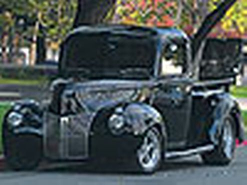 This 1940 Ford pickup received a restoration with aftermarket parts including a Billet steering wheel, electric windows, and leather door panels making it a Ford truck to remember - Custom Classic Trucks Magazine