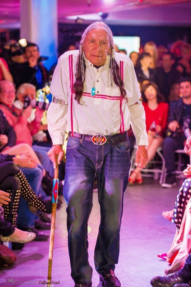 Native American Actor Saginaw Grant leads the Native American Models out to the runway at Fashion Week LA's California Dreaming. The first ever presentation of all Native American models at Fashion Week.  Photo credit: Clint Fotografie