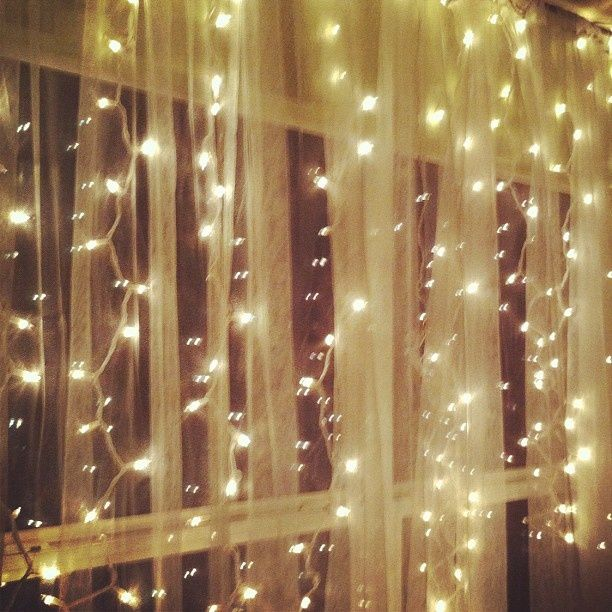 Hanging White Christmas Lights Behind Sheer Curtains