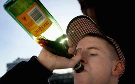 A lad polishes off a bottle of Buckfast tonic wine (Photo: PA)