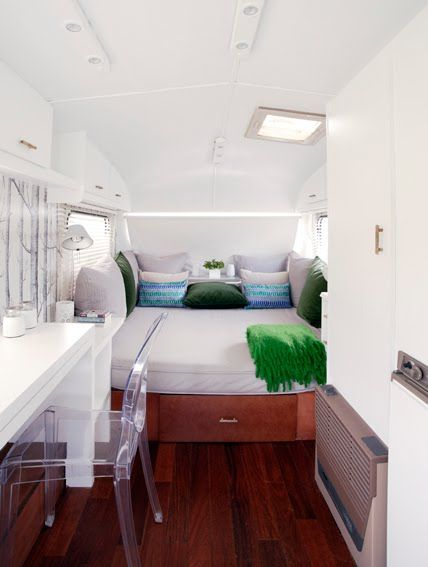 characteristics of the Caravanolic's caravan. Its interior is super-chic and features amazing furniture from different famous brands. Mainly white walls and surfaces is the key to visually enlarge the space and increase the natural light inside of the caravan. Every detail is thought