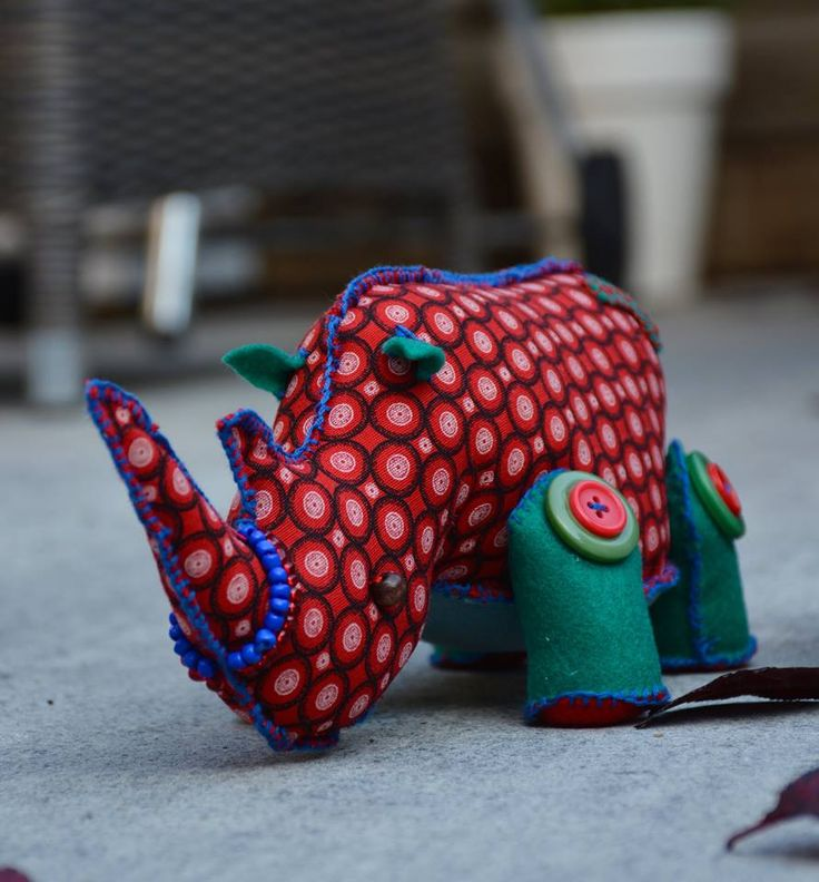 Stoffel, the larger one of the family with an african inspired, red patterned body can be used as a door stop and would love to come home with you for only 22 euro!