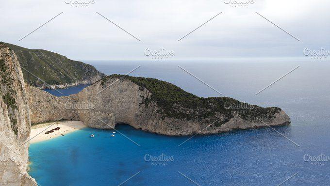 Beautiful Navagio beach panorama with shipwreck on Zakynthos island in Greece by Elgreko on @creativemarket