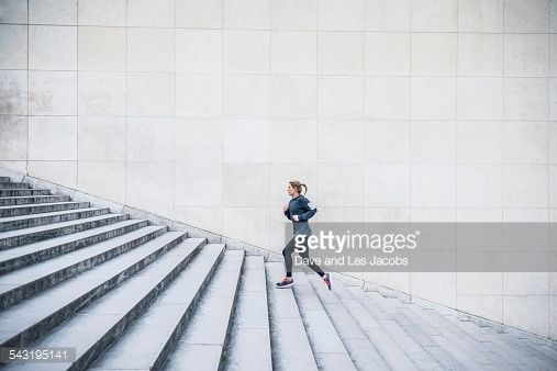 Stock Photo : Caucasian woman running up staircase