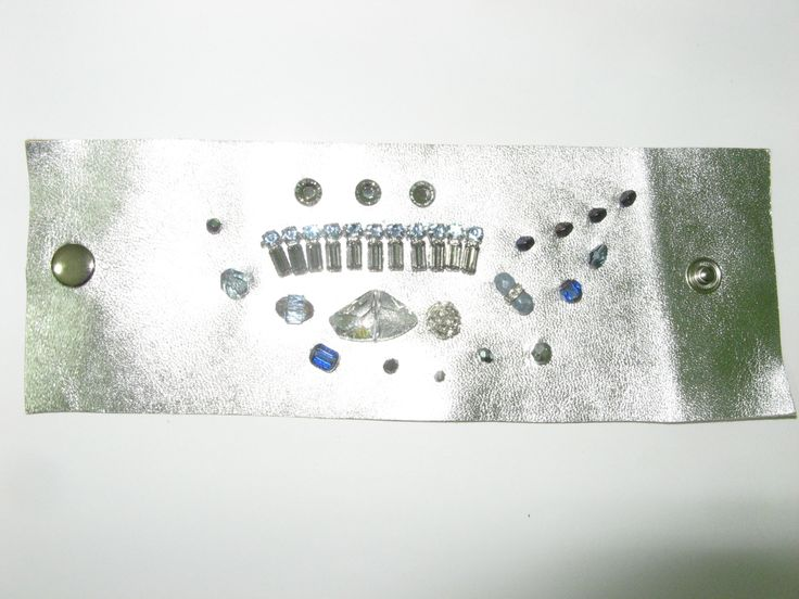 Leather cuff (1 pc)  Made with silver leather, swarovski crystals, crystals, glass beads and metal parts.
