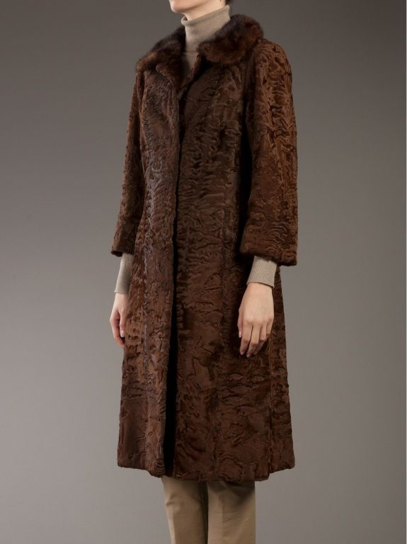Astrakhan coat with a contrasting fur round collar and concealed hook fastening. The sleeves are slightly cropped and the coat falls to just below the knee | Russia, 1920's