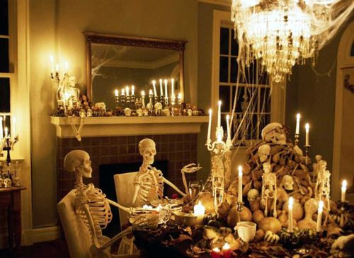 Sit a couple skeletons down at your Halloween buffet table--Love it!