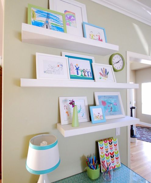 love the artwork shelves and paint color