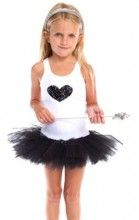 A wonderful cotton singlet style tutu dress. The skirt has 7 layers of tulle cut to create a puffy tutu. The white singlet top has a full sequined heart . Designed to be worn everywhere. The style is modern and very cool.  Spoil the little princess in your life…..she will love it!
