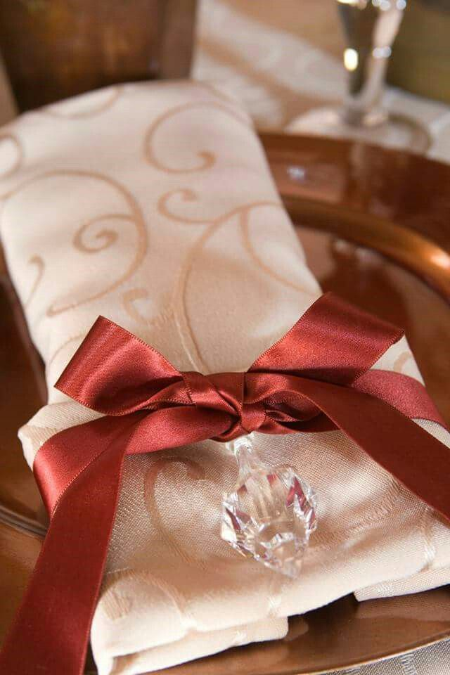 Burnt orange lint and cream damask serviette setting with bronze underplate found at Angel Light