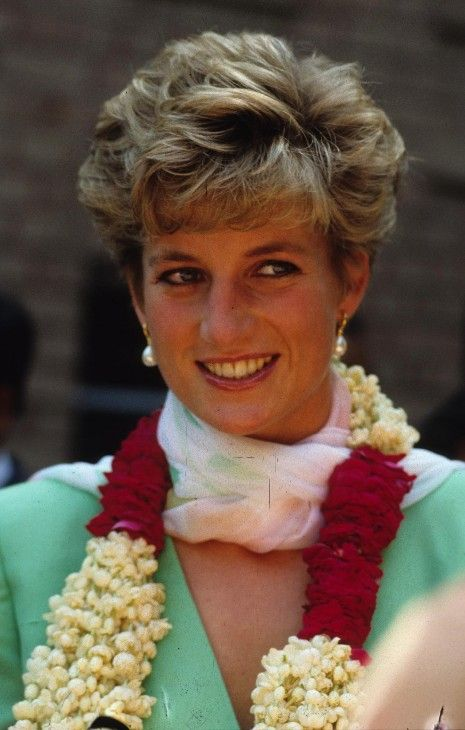 Princess Diana | Photo | Who2~~ The Princess wears a garland during her visit to Lahore,Pakistan~~October 1991