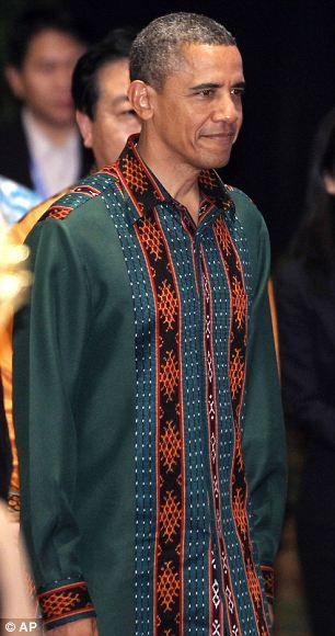 U.S. President Barack Obama wears a traditional Ikat shirt made from woven cloth, at the East Asia Summit dinner in Nusa Dua, on the island ...
