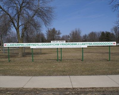 Very Long Welsh Sign at Lake Crystal, MN. -photo by Siren Hunter, via Unusual Signs on Waymarking;  This pronunciation nightmare is on South Main Street in the town of Lake Crystal, Minnesota.