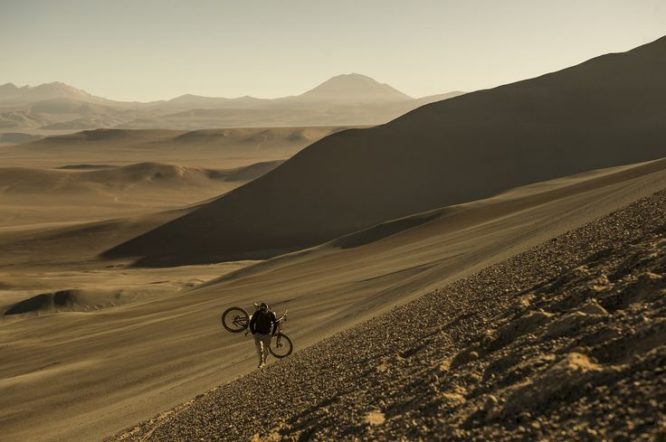 "A Lonely Walk - Markus Stoeckl hikes uphill with his bike for a training session in the Chilean Andes in Chile on 12 December, 2016. <a href=""https://www.redbullphotography.com/editors-choice/AP-1QQXD527H1W11"">Click to see more on redbullphotography.com</a> Marcelo Maragni / Red Bull Content Pool"
