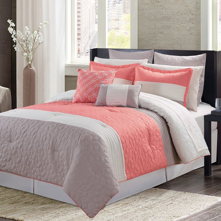 Featuring a beautiful coral, taupe and ivory stripe pattern, update the look of your bedroom with this classic meets contemporary 9-piece bed ensemble. This bed set will add color and beautiful dimension to your bedroom.