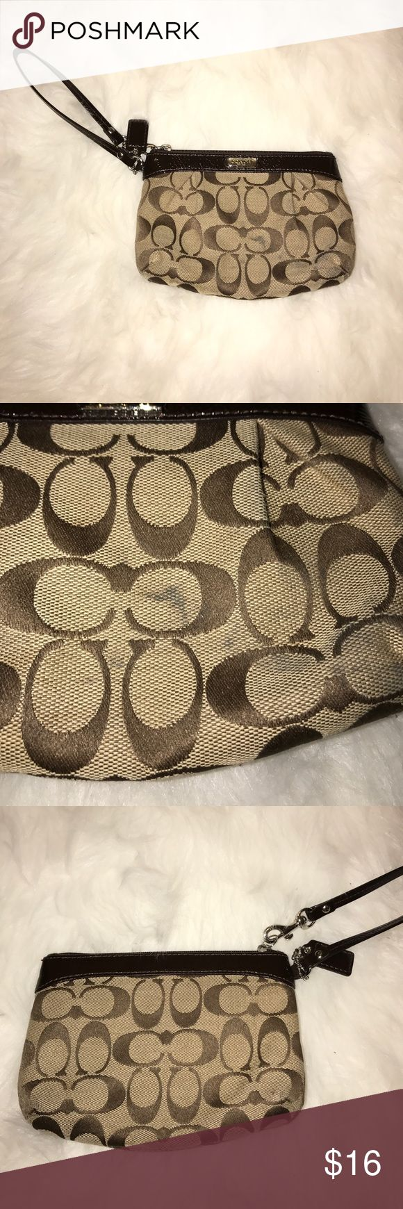 COACH CLUTCH!!!! It is definitely used, but great size and perfect to grab and go with. The stains are reflected in the front picture and there's small stains inside. They could easily be cleaned and it would be back to new, I just have so many and haven't taken the time to do so. (sorry mom) Coach Bags
