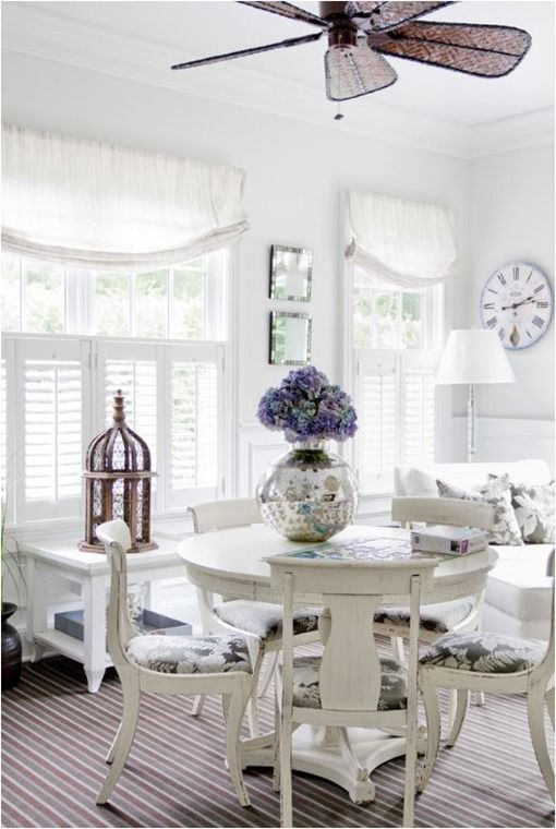 Love these linen shades. white sunroom dining space
