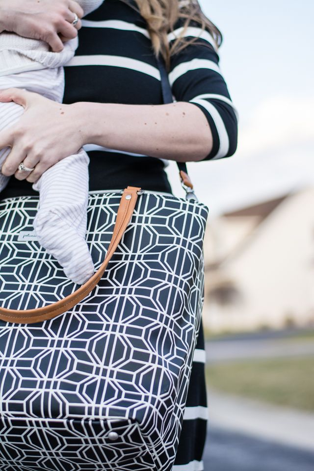 We love how Bella (of Bella the Blog) paired our Altogether Tote diaper bag's geometric shapes with a striped dress for an afternoon stroll with her baby.