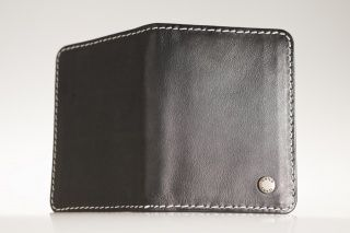 Card Black Special-card holder Exclusive black, real leather credit- and business card holder, with white stitching outside, in which there is room also for the identification card and driving licence. Unisex design with 6 cases, both for ladies and gentlemen. Price: 25.00 EUR