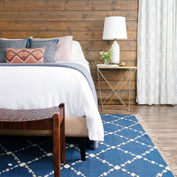 Bedroom With Shiplap Accent Wall | HGTV >> http://www.hgtv.com/design-blog/design/our-favorite-spots-to-use-shiplap-around-the-house?soc=pinterest