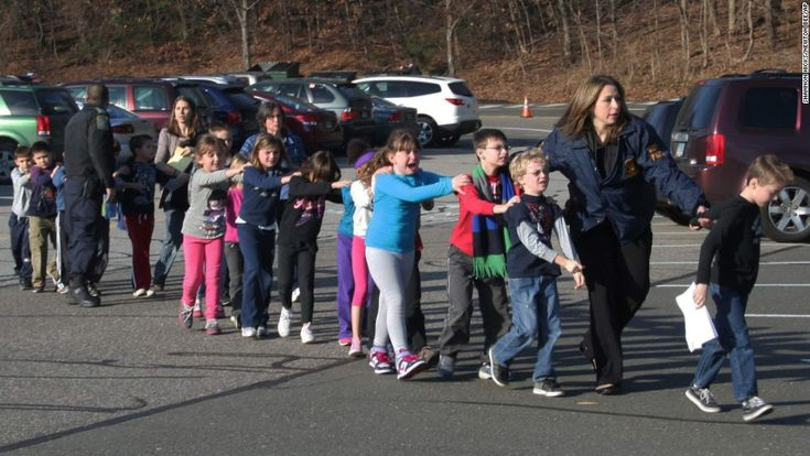 police escorting children out of the school in Newtown, Connecticut.