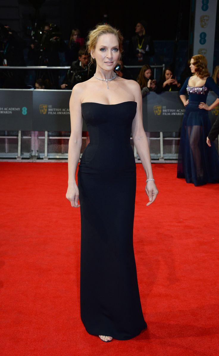 Uma Thurman on the 2014 BAFTA Red Carpet: Uma Thurman wore a classic strapless black column dress.
