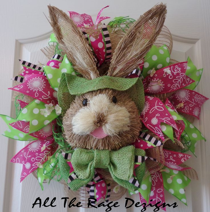 """Bunny Wreath – Ready for Easter and Spring! Brand new hot pink faux burlap w/white floral printed ribbon highlights this Bunny wreath; base of burlap mesh, lime netting, and additional gorgeous ribbon. We even added a little customizing to the bow! Approx. 20"""". $65 https://www.Etsy.com/shop/AllTheRageDezigns"""