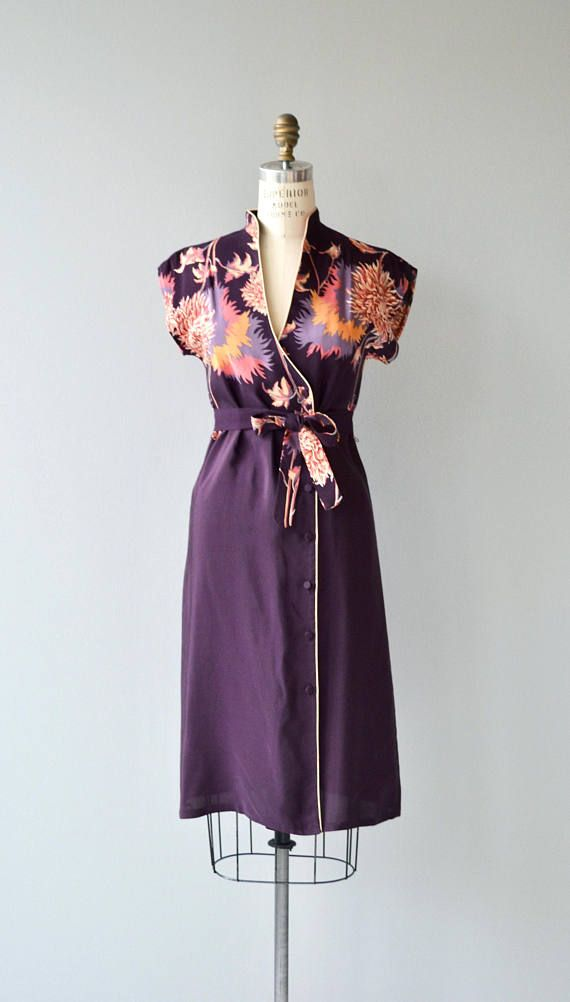 Vintage 1970s dark eggplant rayon dress with fantastic floral print, piping trim, short kimono sleeves, asymmetrical button closure, self-fabric tie belt, unlined and not sheer. Opens all the way and can be worn as a long jacket as well. --- M E A S U R E M E N T S --- fits like: best fits small bust: 33-34 waist: up to 32 hip: up to 37 length: 40.75 brand/maker: Malibu Media condition: excellent to ensure a good fit, please read the sizing guide: http://www.etsy.com/sho...