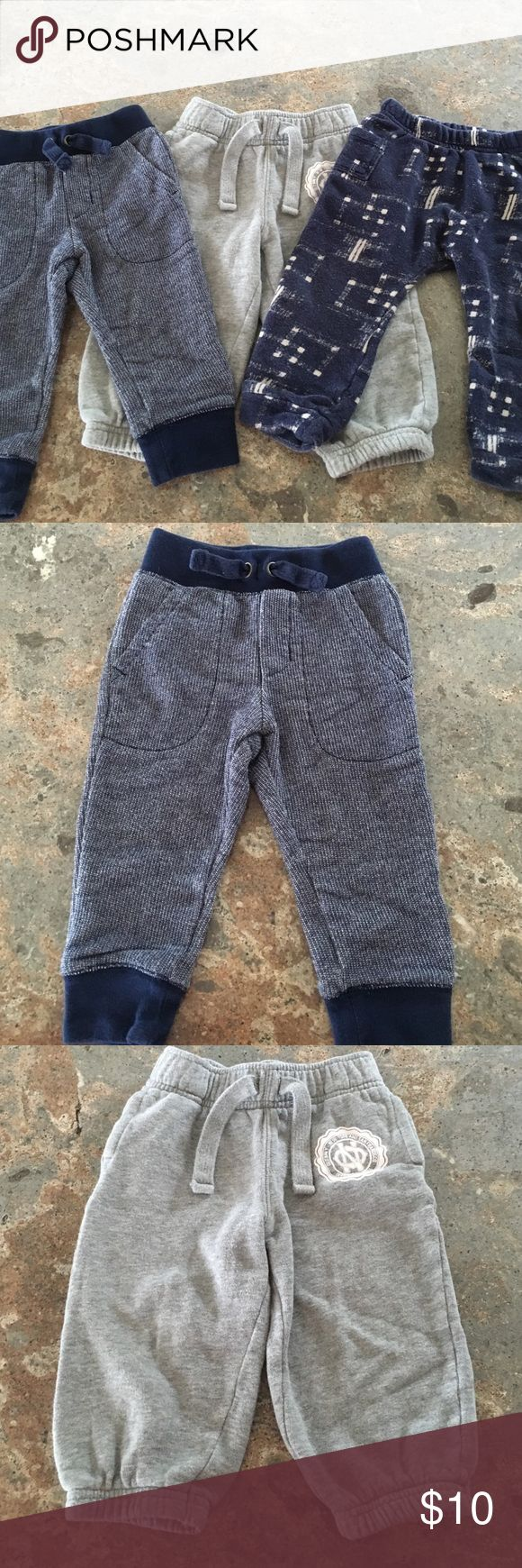 Toddler boy jogger sweatpants bundle! The plain navy pants are Cherokee brand and are size 12 months. The grey sweats are from old navy size 12-18 months. And the printed navy ones are size 18-24 months and are old navy brand as well. All in good used condition and all have piling and minor fading from washing. Old Navy Bottoms Sweatpants & Joggers