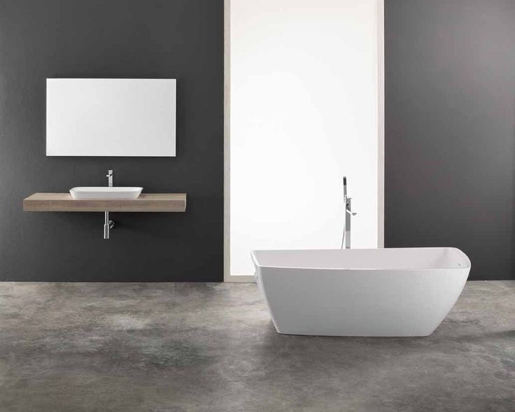 Yole is the perfect choice for contemporary bathrooms - a simple, but striking asymmetrical bathtub, with two straight and two curved sides. Available freestanding, corner or flat wall, Yole is made from smooth white Mitek, an innovative composite material. alternativebathrooms.com