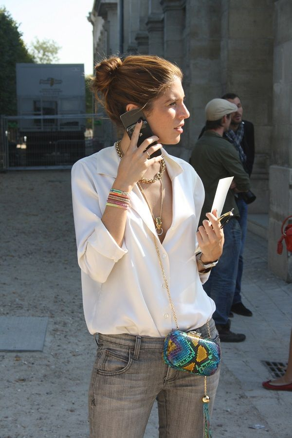 Paris Street Style - a white silky shirt to grey jeans mixed with delicate jewelry and a statement purse is the secret to effortless french style.