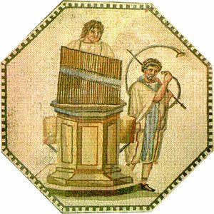 The hydraulis is the first clavier musical instrument in the world and a predecessor of the pipe organ. The Greek inventor Ktisivios created it in the 3rd century BC, in Alexandria. It consists of a set of pipes, with or without a reed. The player (pict. 12) supplies air to a selected pipe through the use of specific keys. The steady supply of air pressure is provided by a hydraulic system.