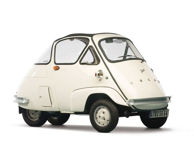 In 1954, VELAM acquired a licence from Iso to manufacture a car based on the Isetta. Since Iso had sold the body making equipment to BMW, VELAM developed their own body but used the original Iso engine. The VELAM body was rounder and more egg-like than Iso's Isetta and was known by the French as the 'yogurt pot'. Instead of a chassis like the Italian and German versions, there was a sub-frame bolted to the body at the rear, which held the rear tires, engine, and transmission.