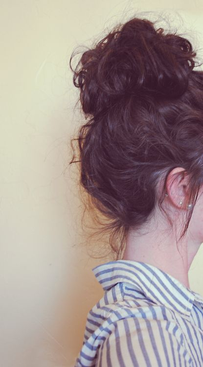 Curly top knot. Too bad mine will never cooperate like that.