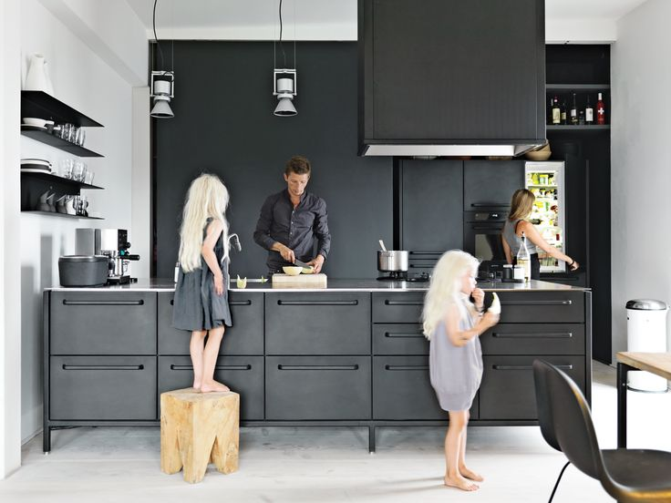 """Twin daughters Merle and Anine join their parents in the family's kitchen, designed by Jensen for Vipp. He explains that his role of chief designer at Vipp is to """"work with their DNA"""" by refining the company's trademark materials: stainless steel, painted, metal, and rubber. For the utilitarian kitchen, """"we wanted to get the feeling of a tool"""" he says. """"It's nice to have a space where you can actually work."""" The gas stovetop is by ABK and the refrigerator is by Smeg; Le Perroquet spotlights…"""