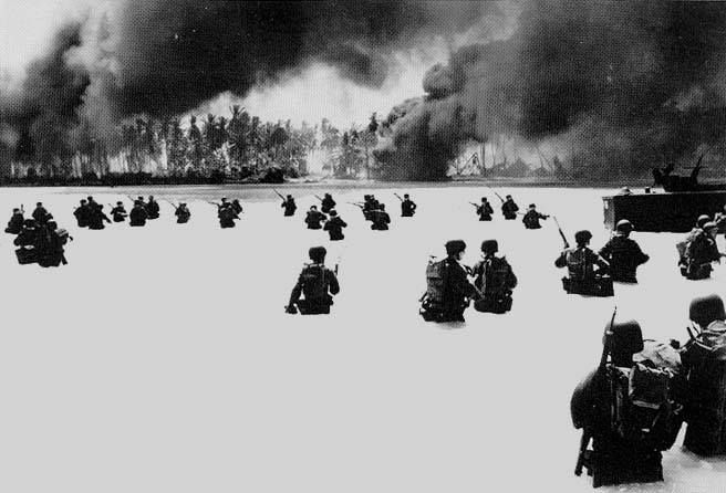 Soldiers of the US Army's 2nd Battalion 165th Infantry struggle to shore on Yellow Beach on Butaritari Island.