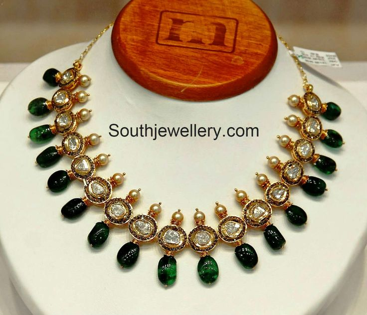 Emeralds, polki diamonds and south sea pearls 22 carat gold necklace from Sri Mahalaxmi.