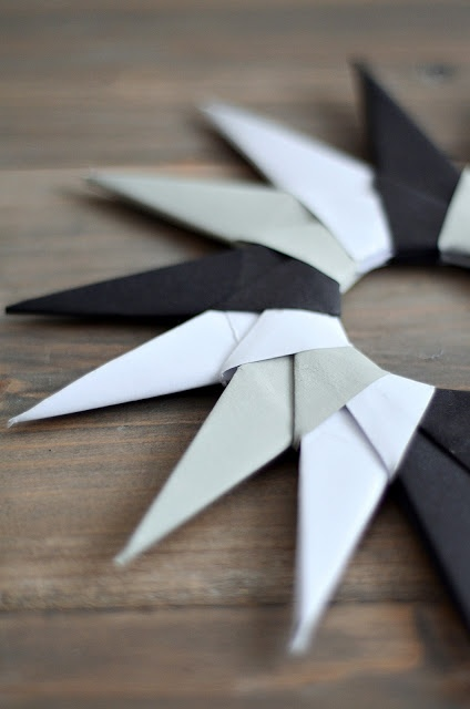 Origami Star - The site is in German, but the pictures allow you to see exactly what to do.