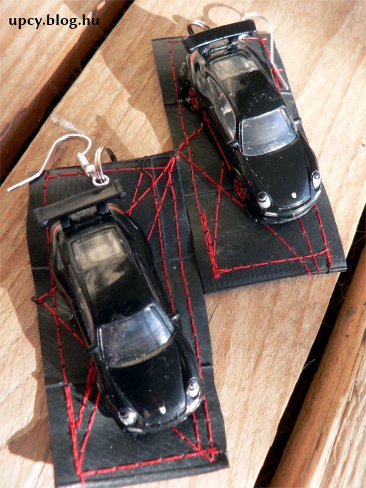 One and only earring from plastic car toy and bike tube. Charity project.  Műanyag játékautó és bicaj gumibelső fülbevaló, teljesen egyedi darab. A Kössünk Össze jótékonysági vásárra készült.