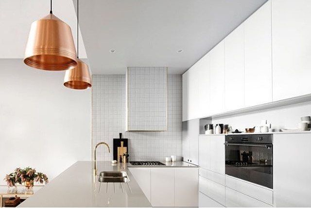 Our copper Cooper pendants add a little warmth to this lovely fresh kitchen by Katherine Willis Interiors