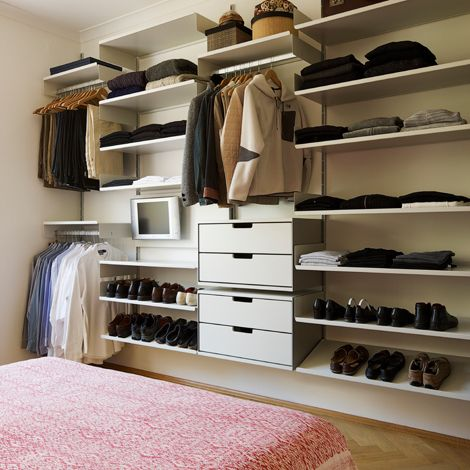 Open shelving in bedroom or dressing room from Vitsoe