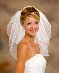 Acconciatura da sposa capelli corti con velo