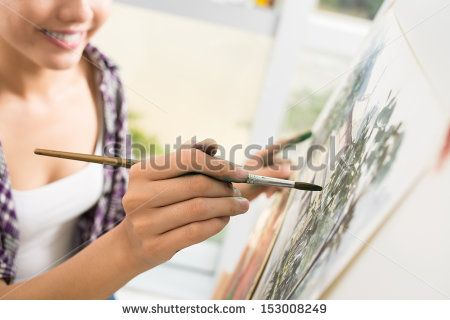 cropped image of an artist drawing a picture on the foreground