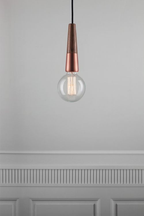 The 'Stripped' suspension set by Nordlux, detailed in copper and walnut.